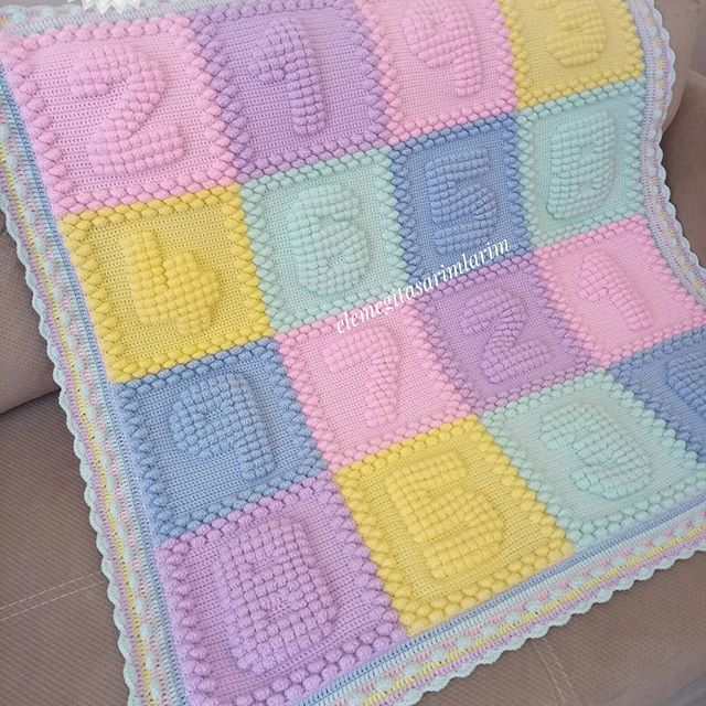 Knitted baby blanket with numeric design