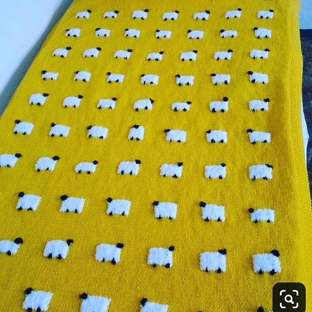 Knitted baby blanket with sheep design